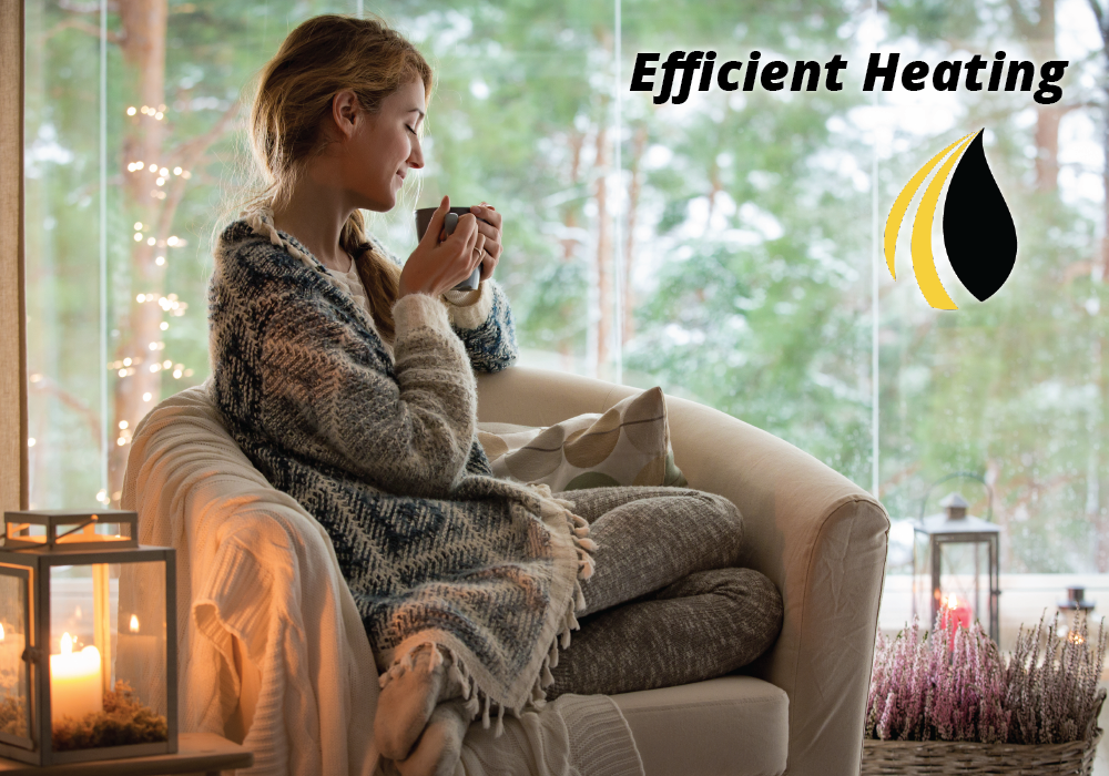"Woman sitting in chair at home with coffee cup. ""Efficient heating"""